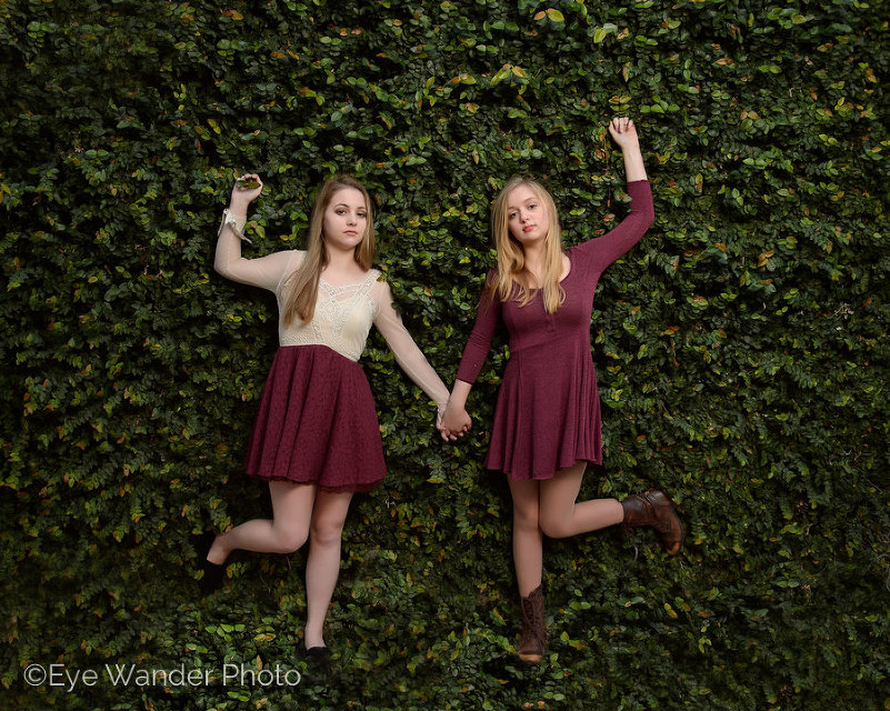 sisters on ivy wall - artistic family photography in baton rouge